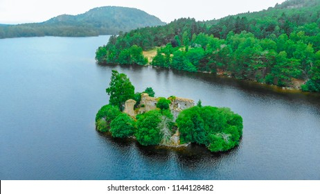 View over Loch an Eilein Castle at Cairngorms National Park in Scotland