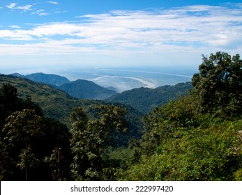 View over the lower section of the Himalayan mountains in India as seen from Bhutan with the lush green forests in front