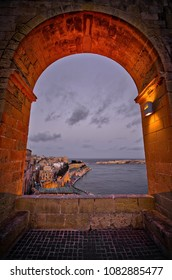 View over Malta harbor and Victoria Gate in Valletta. Looking down from ancient arch.