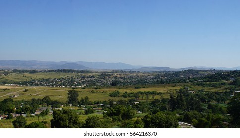 View over the Middleveld in the Kingdom of Swaziland, villages and fertile countryside, in the background the Lubombo Mountains, cloudless sky/Landscape in Kingdom of Swasiland