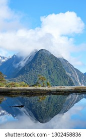 View over Milford Sound, New Zealand. Peaks reflected in fjord.