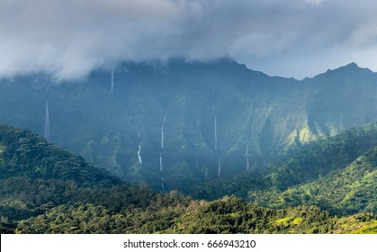 View over Na Pali range after a storm with cascading waterfalls near Hanalei, Kauai, Hawaii
