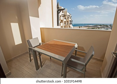 View over ocean in luxury tropical resort from balcony with sea view and furniture table chairs