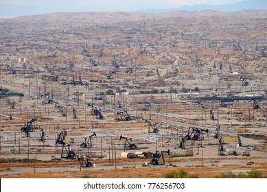View over oil field in Bakersfiled, California, with derricks pumps.