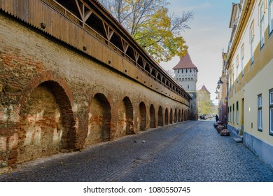 A view over an old brick wall and a tower, which were a part of the fortification  system  in the old town of Sibiu, Romania