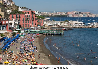 View over one of the beautiful beaches with houses touching the coastline - Naples, Italy 8/2018