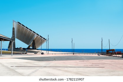 a view over the Parc del Forum public park in Barcelona, Spain, highlighting the giant sculptural photovoltaic panel