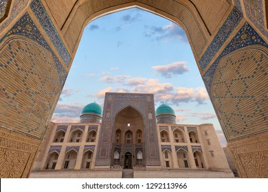 View over the Poi Kalon Madrasah through arch in Bukhara, Uzbekistan