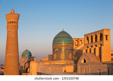 View over the Poi Kalon Mosque and Minaret at the sunrise, in Bukhara, Uzbekistan.