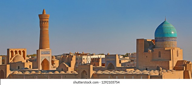 View over the Poi Kalon Mosque and Minaret at the sunset, in Bukhara, Uzbekistan.