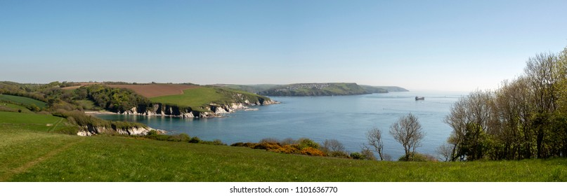 View over Polridmouth Bay and the entrance to Fowe Harbour from the coastal footpath in Cornwall, UK