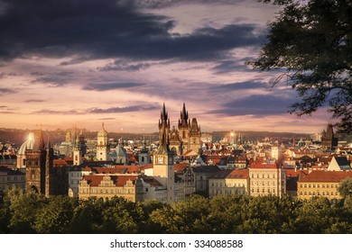 View over red Roofs and Parks of old Prague in the Evening in Summer.