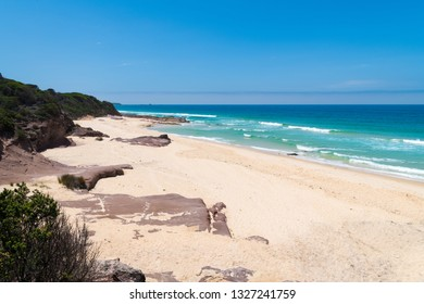 View over remote Quondolo Beach, located in Ben Boyd National Park, NSW, Australia, popular for surfing and rockpool exploring and subject to rips tides and big waves