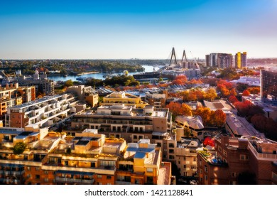 View over residential area from Darling Harbour towards Anzac Bridge and Parramatta River in autumn at sunset in Sydney, Australia.