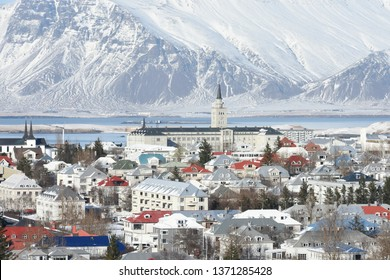 View over Reykjavjik in winter with snowcapped mountains in the background