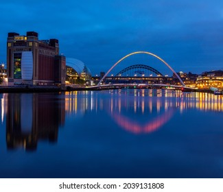 A view over the River Tyne, towards the Gateshead Millennium Bridge, BALTIC Centre for Contemporary Art, Tyne Bridge and the Sage Gateshead, in Newcastle upon Tyne, Northumberland, UK.