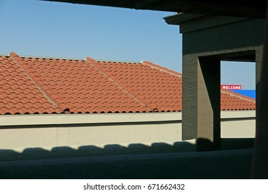 View over a rooftop with a small sign saying Welcome