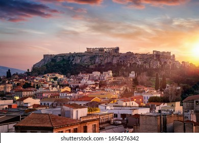 View over to rooftops of the old town Plaka to the Parthenon Temple at the Acropolis of Athens during sunset time, Greece