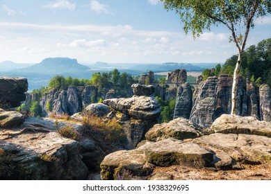 View over Sandstone Rocks to Bastei Bridge and Lilienstein Rock in the Elbe River Valley, Saxon Switzerland National Park, Germany