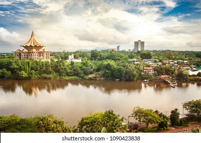 View over the Sarawak River to the north side of the city of Kuching with DUN complex (seat of the Parliament of the Malaysian state of Sarawak) and Fort Margherita, Borneo - Shutterstock ID 1090423838