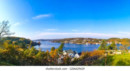 View over the sea and the house on the side of the sea. Arendal city. Norway