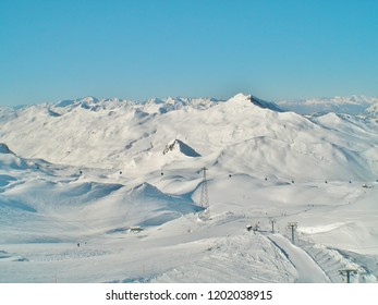 View over the skiing area of Davos in winter with ski lifts, slopes and mountain range. Luxurious Davos has the largest ski resort in Switzerland and is the highest city in Europe with five ski areas