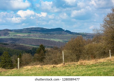View over the southern Eifel hills near Daun, Germany to a tall communications tower.