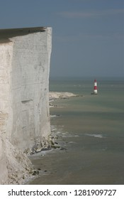View over steep cliff, and lighthouse at Beachy Head, in East Sussex, England