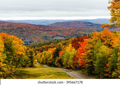 View over the surroundings hills and meadows of Mont-Tremblant during Autumn, Quebec, Canada