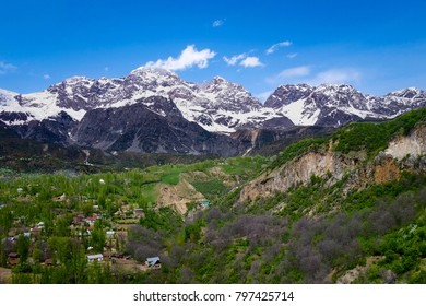 View over the town and walnut forests of Arslanbob village in southern Kyrgyzstan, with mountains in the background