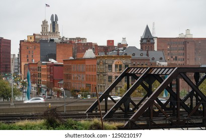 View over the train tracks and highway to the buildings of main street in downtown Rochester New York