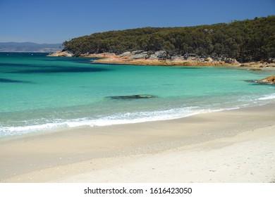 View over turquoise waters of Hazard Beach (next to Wineglass Bay), Freycinet National Park, Tasmania, Australia