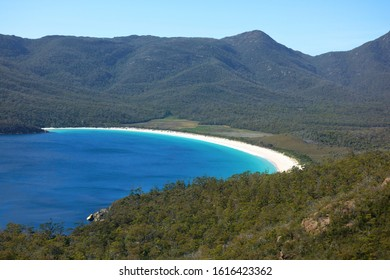 View over turquoise waters of Wineglass Bay, Freycinet National Park, Tasmania, Australia