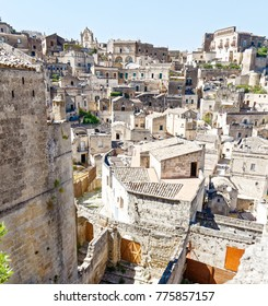 View over the unesco town of Matera, Basilicata, Italy.  Matera is a city on a rocky outcrop in the region of Basilicata, in southern Italy. It includes the Sassi area, a complex of cave dwellings.