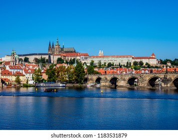 View over Vltava River and Charles Bridge towards Castle with Cathedral, Prague, Bohemia Region, Czech Republic