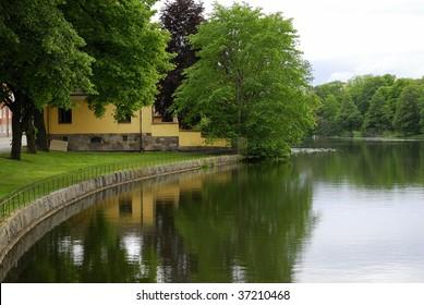 View over the water (Eskilstuna river) flowing through the city of Eskilstuna in Södermanland, Sweden.