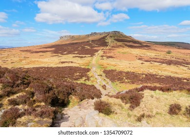 The view over the wide expanse of the Derbyshire Peak District to Higger Tor on a bright spring day.