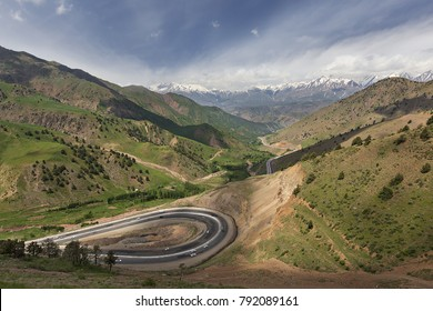 View over the winding roads and mountains between Tashkent and Fergana Valley in Uzbekistan.