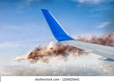 view over the wing of a flying plane high in the sky to a burning and crashing aircraft