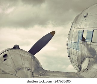 view over the wing of a historic airplane, vintage style