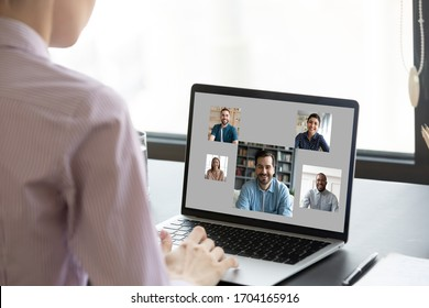 View over woman shoulder pc screen, diverse people faces on laptop monitor. Employer choose vacancy candidate after distant job interview, virtual chat communication, video call app, e-date services