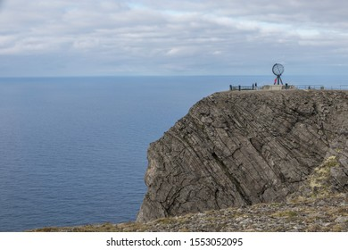 View over the world famous North Cape rock above the arctic sea with the globe sculpture on top in rare sunshine