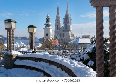 View over Zagreb during winter with snow with view to towers of church and cathedral and seating area a sunny day, Zagreb, Croatia, Europe