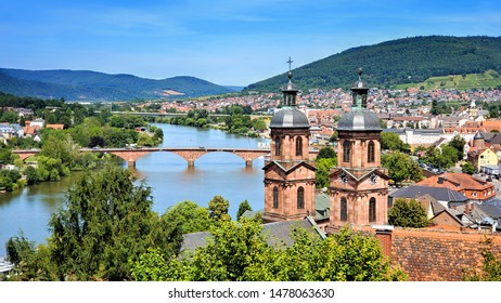 View overlooking the beautiful town of Miltenberg, Bavaria, Germany with old bridge and church spires