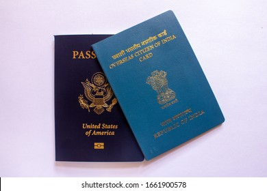 View of Overseas Citizen of India Card issued to non resident Indians along with US Passport. Travel document, - Shutterstock ID 1661900578