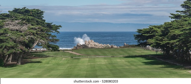 View from the Pacific Grove Golf Links, along the Monterey Bay of central California, with waves breaking along the rocky coast below.