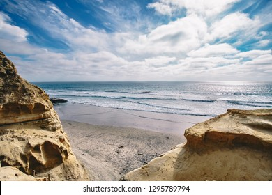 A view of the pacific ocean from the sandstone bluffs of Torrey Pines Beach hike in San Diego, California, United States.