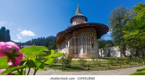 View of painted church in medieval monastery in romanian village Voronet, Romania
