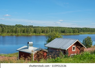 View from Pajala in northern Sweden across Torne river on a sunny summer day in August 2018
