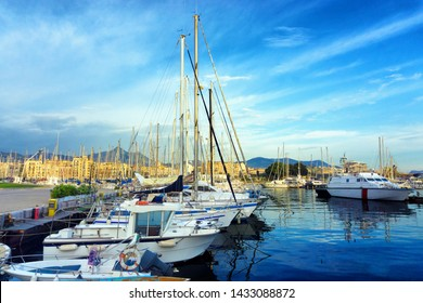 View of the Palermo Harbor with boats and the city in the background in Sicily, Italy